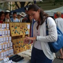 Jarmila Gojdosova looking at a ring at Salamanca Markets