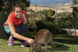 HOBART, AUSTRALIA - JANUARY 05:  Laura Robson of Great Britain feeds a joey on a visit to Bonorong Wildlife Sanctuary during day two of the Hobart International at Domain Tennis Centre on January 5, 2013 in Hobart, Australia.  (Photo by Mark Metcalfe/Getty Images)