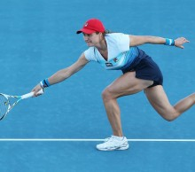 Romanian Monica Niculescu stretches for a shot in her upset win over Mona Barthel. Picture: Getty Images