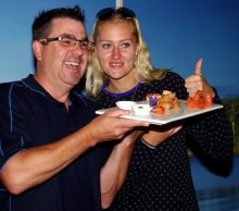 Thumbs up. Kristina Mladenovic is a fan of Tasmanian salmon. Picture: Casey Gardner