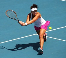 Casey Dellacqua in Fed Cup singles action at Hobart's Domain Tennis Centre; Getty Images