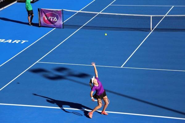 Australian Belinda Woolcock serves up her best. Picture: Kaytie Olsen