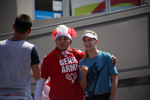Canadian star Eugenie Bouchard meets a fan at the Domain Tennis Centre. Picture: Kaytie Olsen
