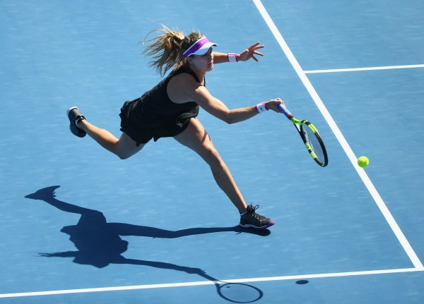 FINAL BOUND: Canadian Eugenie Bouchard in flight during today's semifinal. Picture: Getty Images