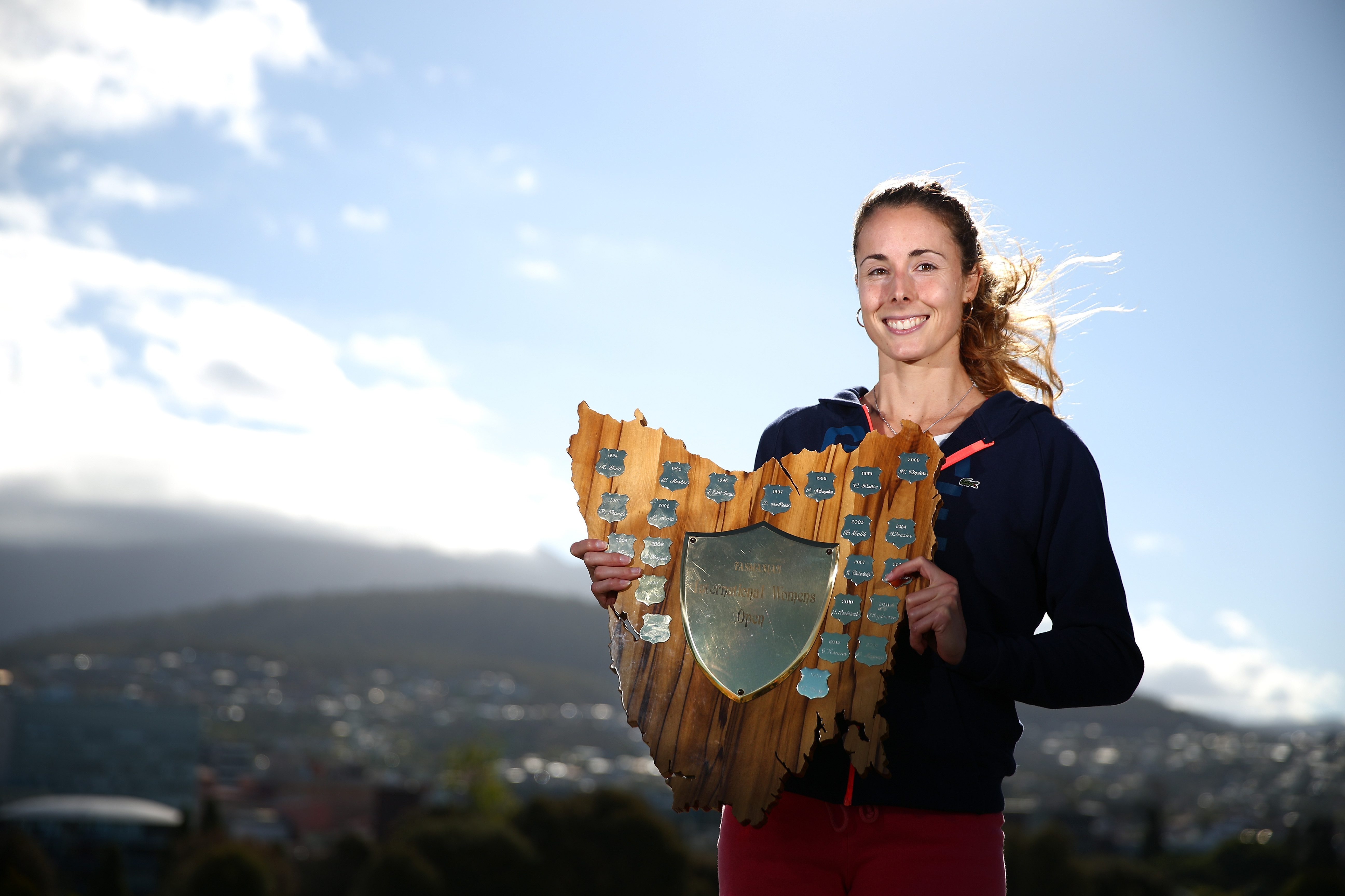 Hobart International 2016 champion Alize Cornet with her trophy overlooking the picturesque Mt Wellington.  Picture: Getty Images