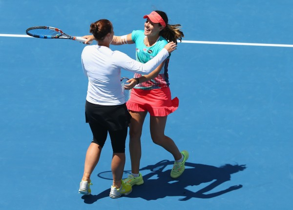 ELATION: Australians Jarmila Wolfe and Kimberly Birrell celebrate after winning their doubles semifinal today. Picture: Getty Images