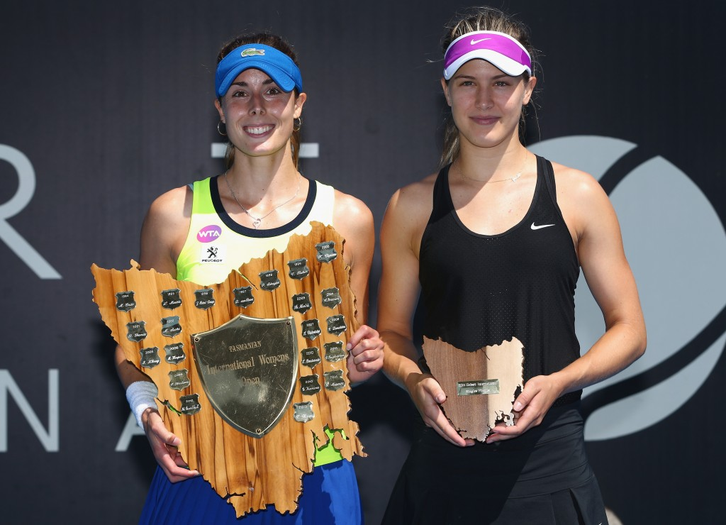 HOBART, AUSTRALIA - JANUARY 16: Winner, Alizé Cornet of France and runner up Eugenie Bouchard of Canada pose after the singles finals match during the 2016 Hobart International at the Domain Tennis Centre on January 16, 2016 in Hobart, Australia.  (Photo by Robert Cianflone/Getty Images)