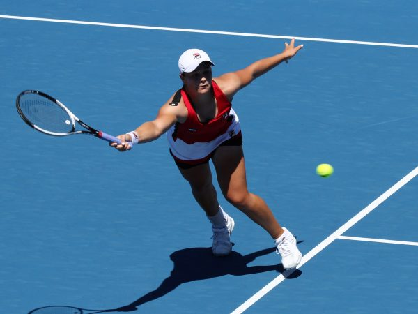 MOVING ON: Australian Ashleigh Barty stretches for a volley during her round two win. Photo: Tim Ikin