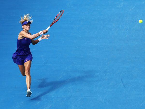 FLYING: Ukrainian Lesia Tsurenko leaps into a forehand during her quarterfinal win over Shelby Rogers; Getty Images