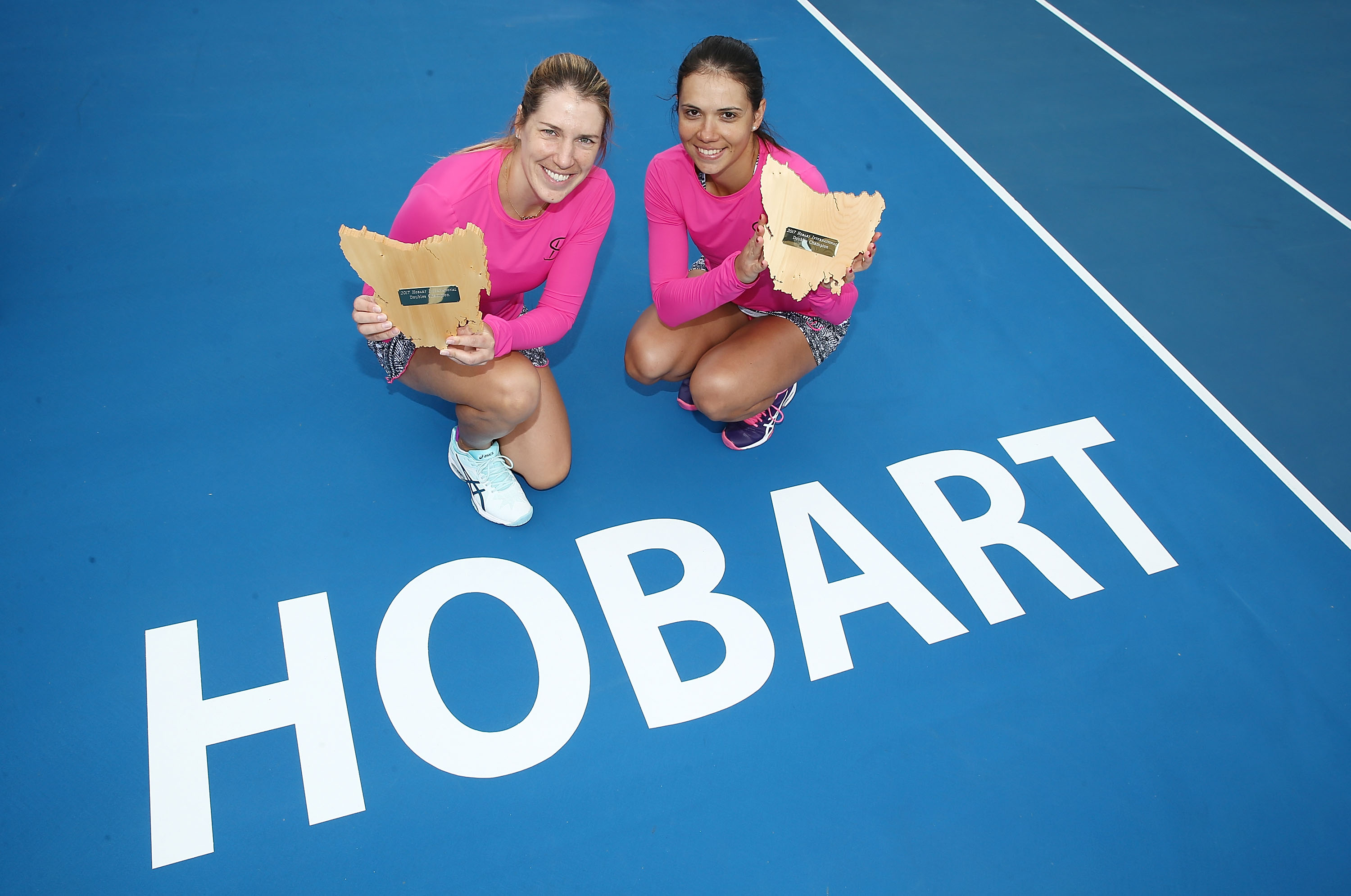VICTORS: Romanian world No.64 Raluca Olaru and Ukrainian world No.58 Olga Savchuk pose with their champions trophies; Getty Images