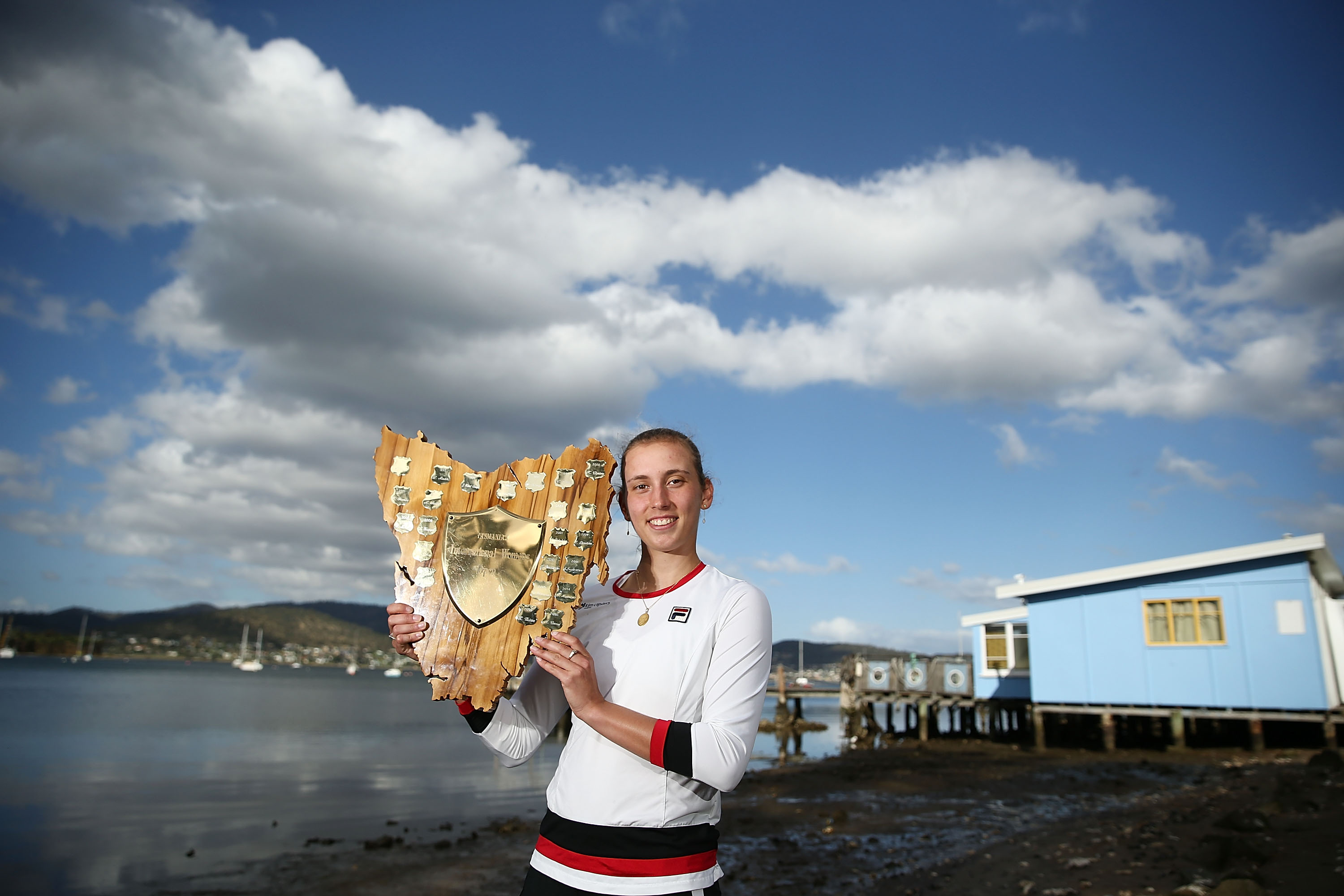 CHAMPION SHOOT:  Elise Mertens poses with the winners trophy at Cornelian Bay after her stunning victory; Getty Images