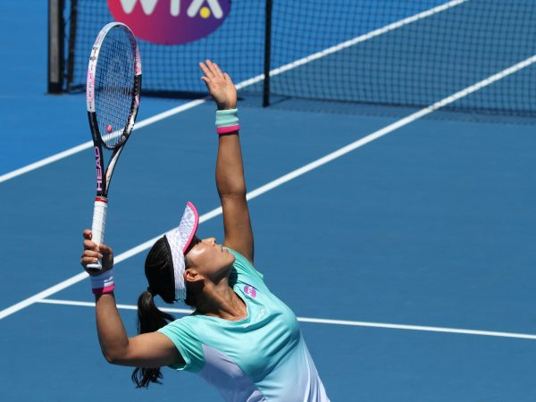 SERVING IT UP: Japan's Risa Ozaki serves during her round one qualifying win. Picture: Tim Ikin