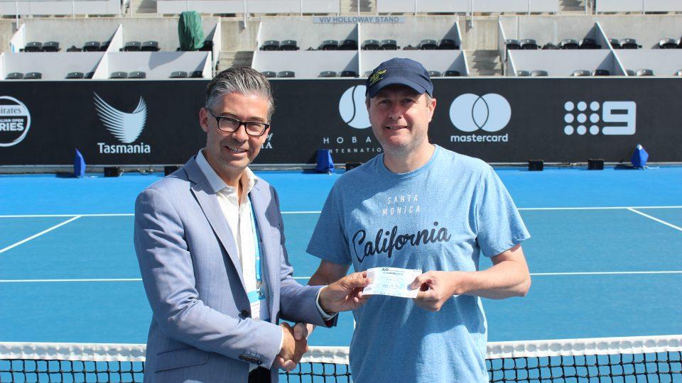 WINNER: Hobart International Tournament Director Darren Sturgess with competition winner Stuart Geeves. Picture: Joe Turmine